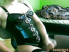 transvestite relative to latex leotard